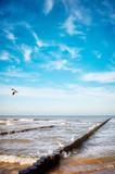 Old wooden groyne on a beach, peaceful natural background. - 186492700