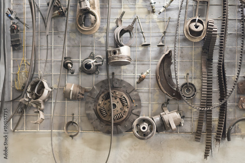 Photo Closeup of different auto spare parts of different cars.