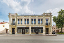 Old Beautiful With Restored Facade Building In Sunny Day Near The Road. Urban Development Of The 19th Century