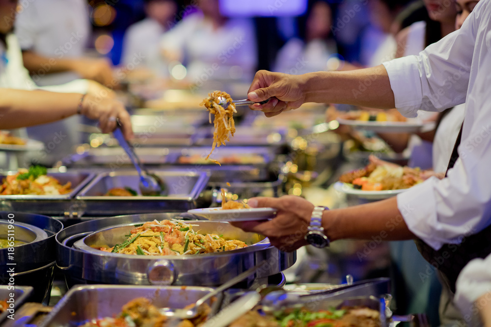 Fototapeta scooping the food. Buffet food at restaurant. Catering food
