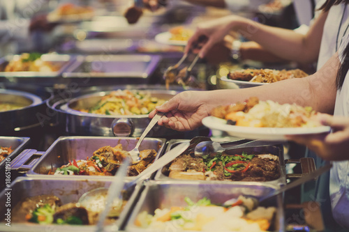 Fotografie, Obraz  scooping the food. Buffet food at restaurant. Catering food