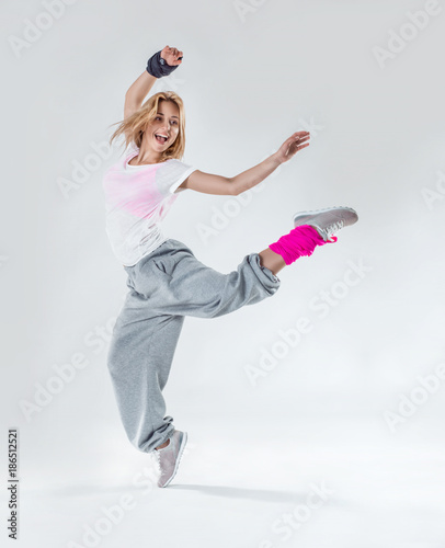 Poster Dance School Young beautiful slim girl dancing on a white studio background