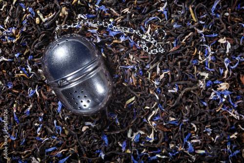 Fotografia, Obraz  Loose leaf tea metal infuser on black tea background with copy space