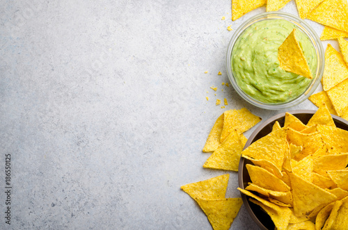 Cuadros en Lienzo Traditional mexican homemade guacamole sauce in a glass bowl and