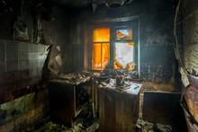 Burnt Apartment House Interior. Burned Furniture And Charred Walls In Black Soot