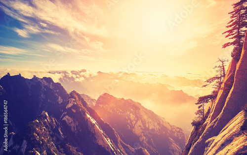 Photo sur Toile Beige Color toned sunset seen form Mount Hua (Huashan) South Peak, one of the most popular travel destinations in China..
