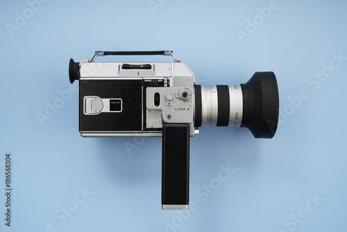 Super 8 Movie Film Camera on Blue Background