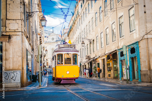 Obraz na plátne  Yellow tram 28 on streets of Lisbon, Portugal