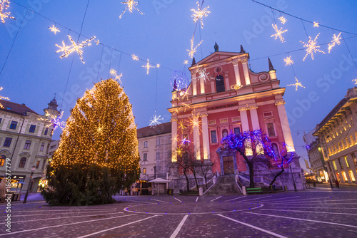 Presern square and Franciscan Church of the Annunciation in Christmas lights in Ljubljana, Slovenia