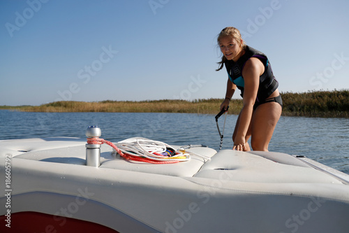 Fotografie, Obraz  Girl preparing to waterski