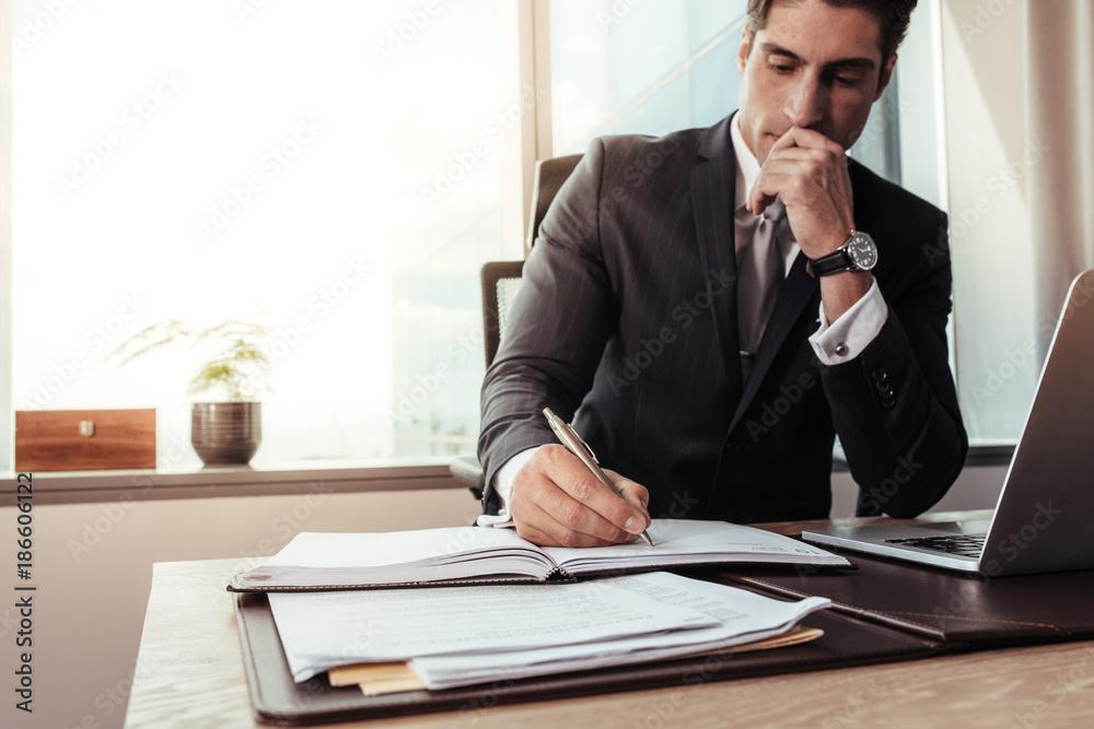 Fototapeta Male entrepreneur working at his desk