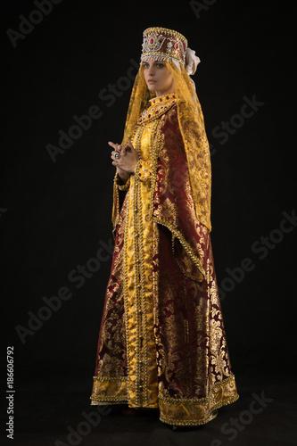 Russian queen in historical dress suit