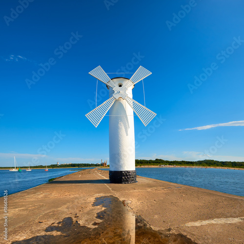 Canvas Prints Mills Old lighthouse in Swinoujscie, a port in Poland on the Baltic Sea