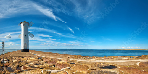 Foto op Plexiglas Vuurtoren Panoramic image of an old lighthouse in Swinoujscie, a port in Poland on the Baltic Sea