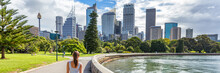 Sydney City Australia Travel Panorama Banner. Landscape Horizontal Header Of Australian Skyscrapers With Person Walking In Park With Skyline In The Background. People Urban Lifestyle.