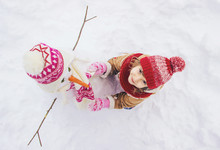 A Child In The Winter In The S...