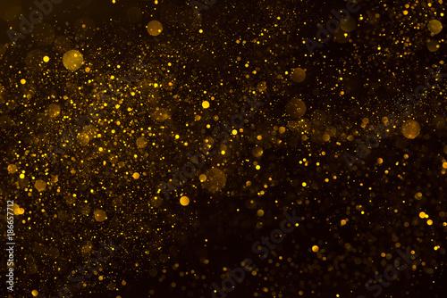 Fotografie, Obraz Golden stardust flow glitter shiny abstract background