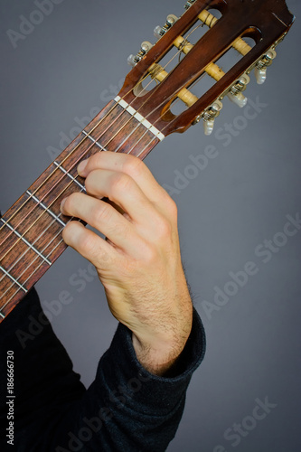 Bb diminished Chord played by Guitarist on classical acoustic guitar ...
