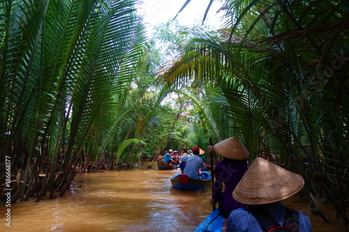 Fotografia  My Tho, Vietnam: Tourist at Mekong River Delta jungle cruise with unidentified c