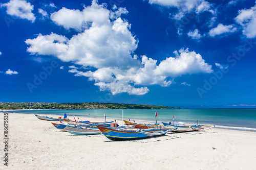 Traditional Bali fishing boats grounded on Jimbaran Beach