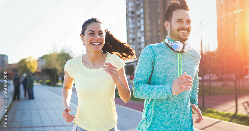 Fototapety, obrazy: Couple jogging outdoors