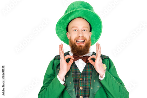 Fotografija excited man in green leprechaun costume and bow tie, isolated on white