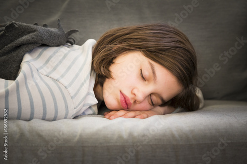 Portrait of girl sleeping on couch