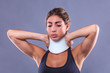 fitness woman with neck ache has a cervical collar