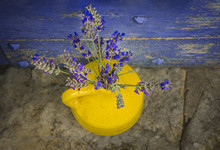 Lavender In A Yellow Vase On A...
