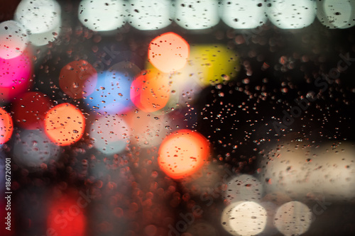 Fotobehang - Abstract blur of light in the night with rain background