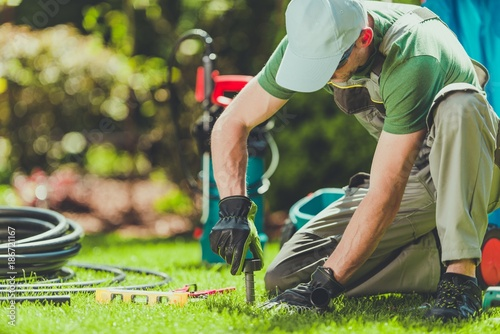 Obraz Grass Sprinklers Installation - fototapety do salonu