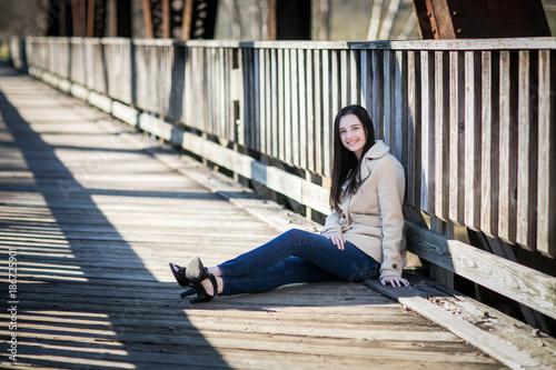 Valokuva  Beautiful exotic young woman on a bridge