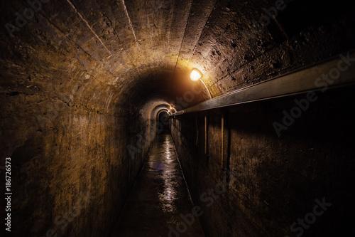 Photo  Dark corridor of old underground Soviet military bunker under artillery fortification