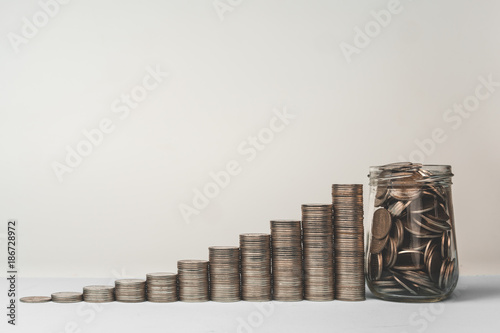 Fotografía  Coin in glass bottle with money stack step up growing growth saving money, Conce