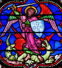 Naklejka Saint Michael Slaying Satan depicted as a Dragon - Stained Glass