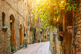 Fototapeta Uliczki - Alley in old town, San Gimignano, Tuscany, Italy