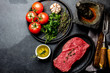 Fresh raw meat beef steak. Beef tenderloin, spices, herbs and vintage cutlery. Food background with copy space