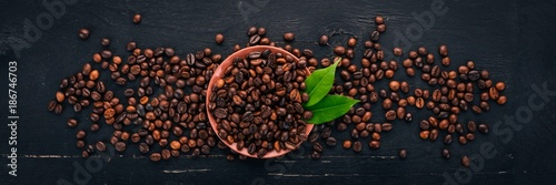 Deurstickers Cafe Coffee beans. On a wooden background. Top view. Copy space.