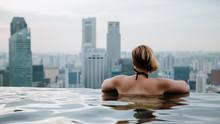 Woman In Infinity Swimming Poo...