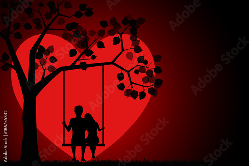 Fotomural Romantic silhouette of loving couple sitting on a swing under a tree on a background of the moon in the shape of a heart