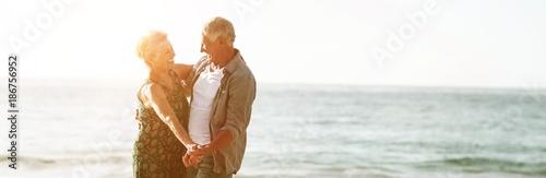 Fototapeta Senior couple dancing at the beach obraz