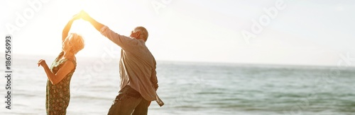 Fotografie, Obraz Senior couple dancing at beach