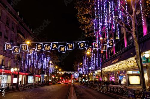 Paris, France - December 4, 2017: Christmas lights on Haussmann boulevard and Pa Poster Mural XXL