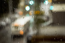 Muni Busses Going Up Haight Street In San Francisco Through A Rain Soaked Window