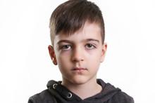 Studio Portrait Of Preschool 5 Yerars Old Boy On The White Background - Neutral Facial Expression