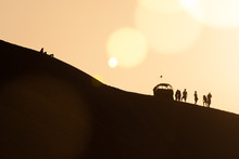 Tourists With A A Dune Buggy In The Desert In Huacachina, Ica, Peru