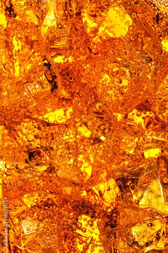 Valokuva  Orange energy soda drink in glass with ice cubes