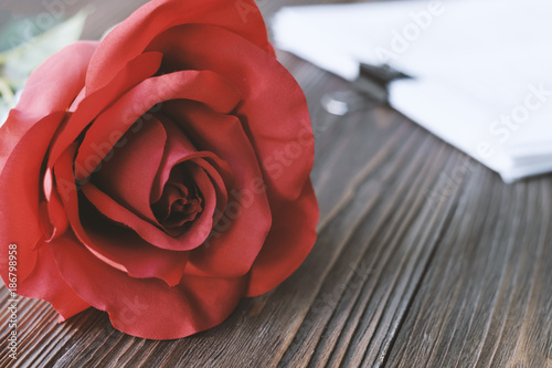 Spoed Fotobehang Rood, zwart, wit Red roses on wooden background,Valentines day celebration
