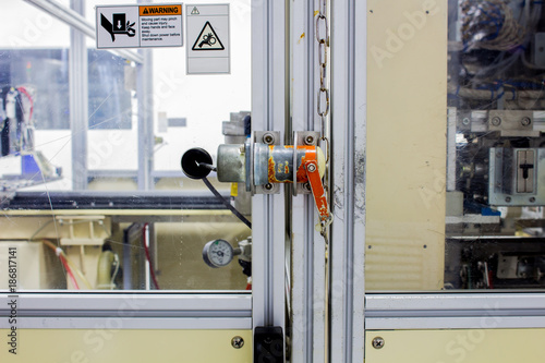 Fotografie, Obraz  The safety plug on door of machine machinery used in work time.