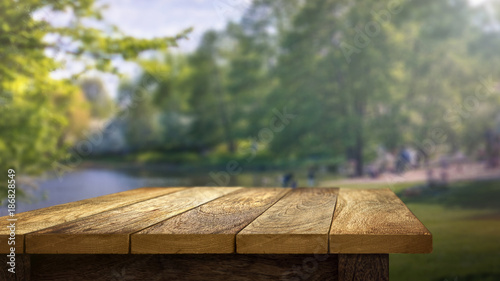 Obraz Wooden Table outside in park background - fototapety do salonu